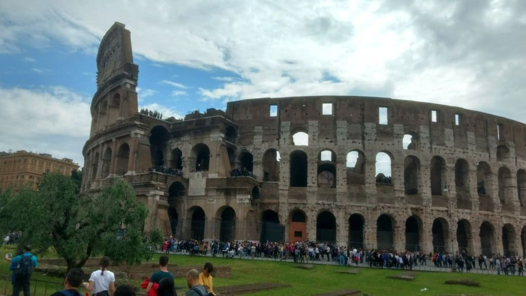 Long line of tourists waiting outside the Colosseum in Rome.
