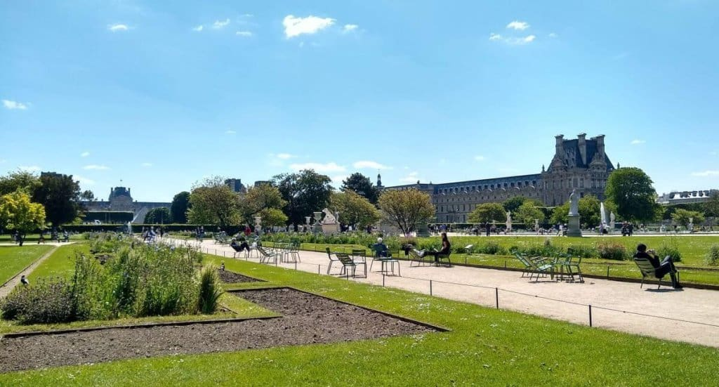 Les Jardin des Tuileries with view of the Louvre and the Louvre pyramid in the background.