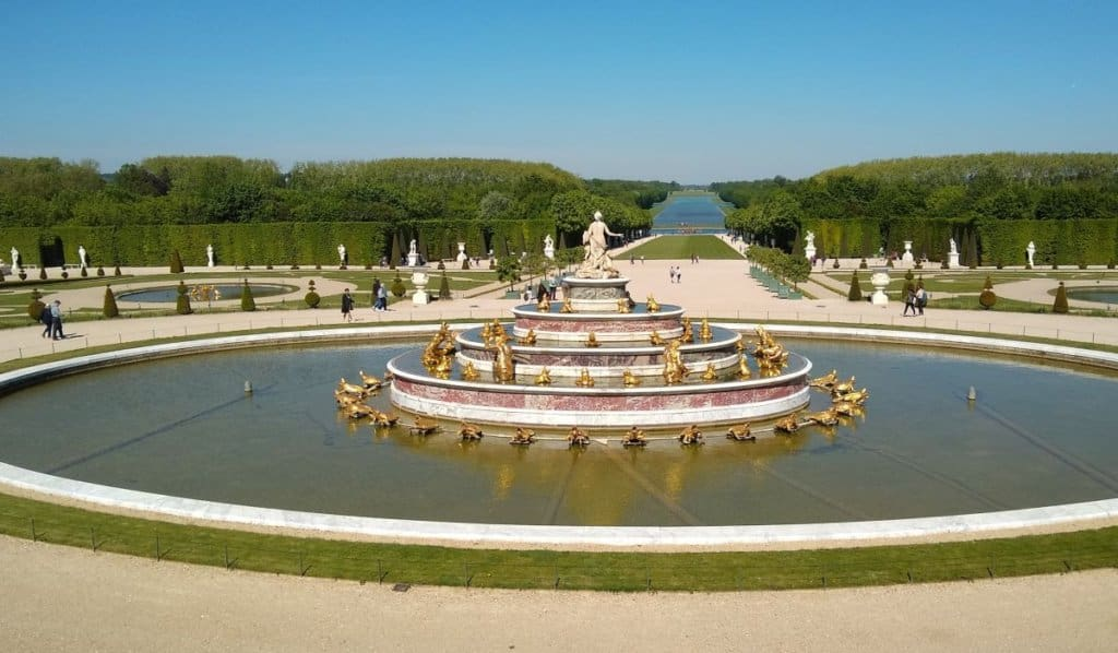 Large fountain at the gardens in Versailles