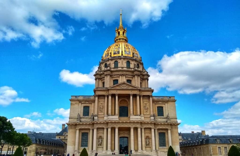 Large 19th Century building in Paris with a gold dome.