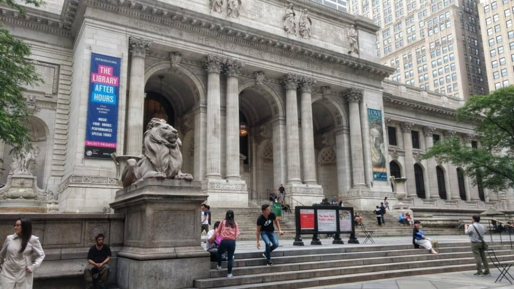 Exterior of a large marble building in New York City.