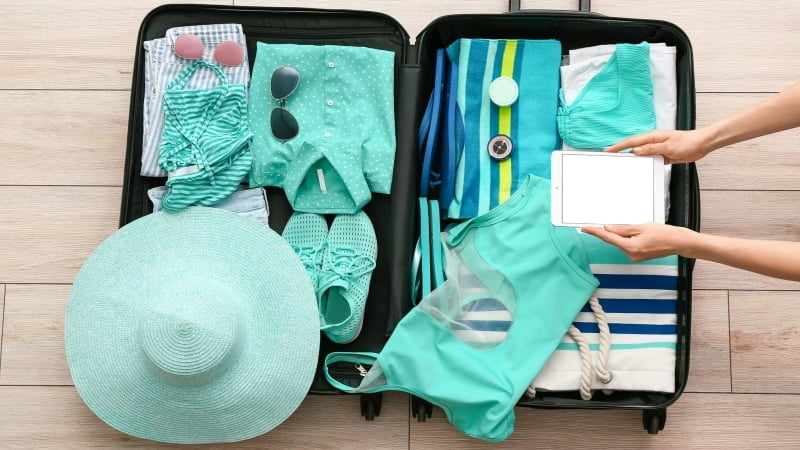Beach clothing packed in an open suitcase